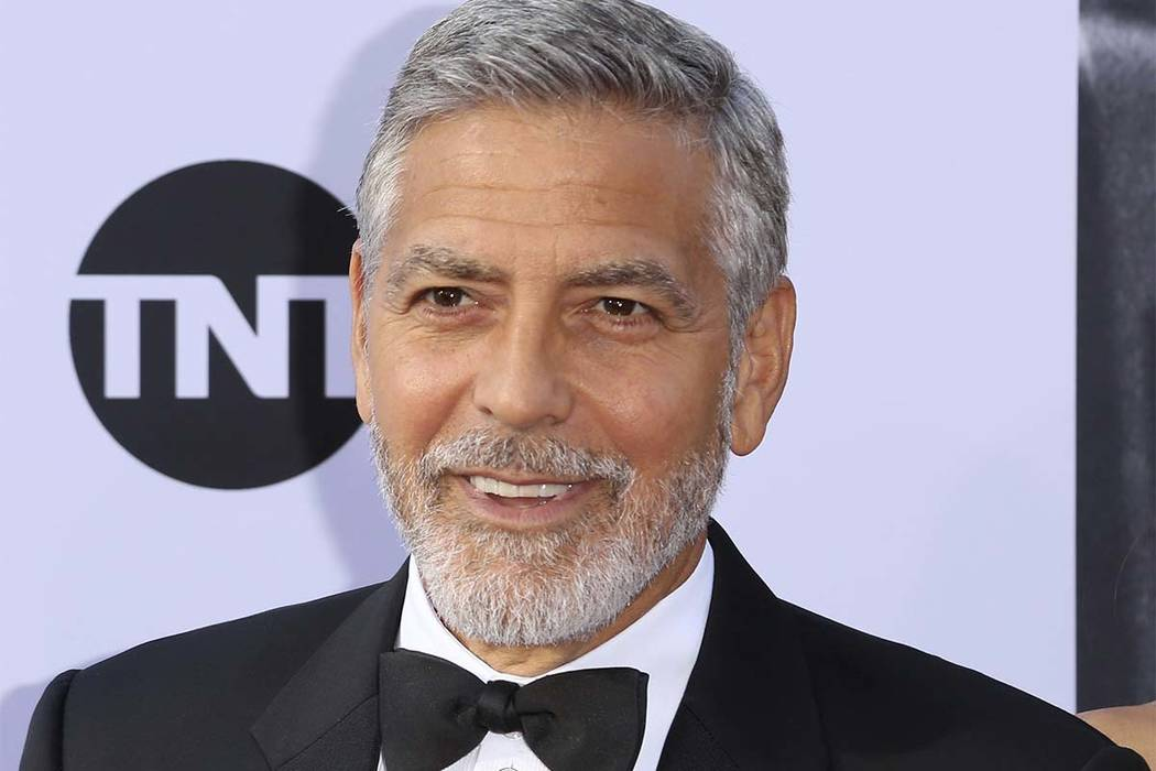 In this Thursday, June 7, 2018 photo, George Clooney arrives at the 46th AFI Life Achievement Award Honoring himself at the Dolby Theatre in Los Angeles. (Willy Sanjuan/Invision/AP, File)