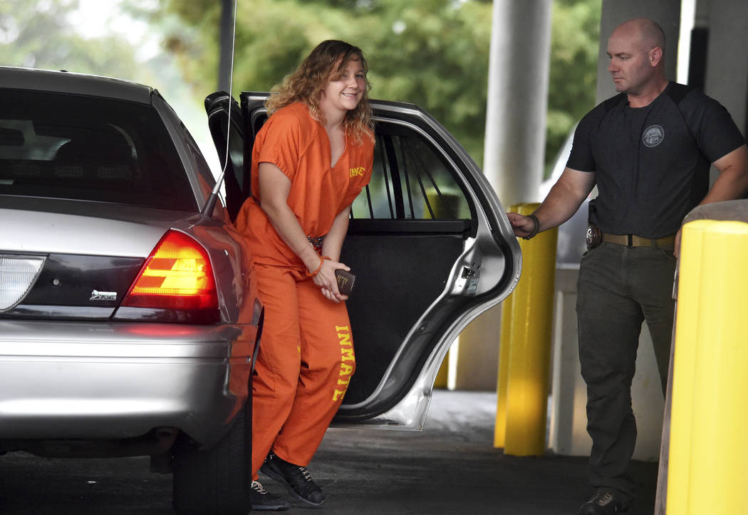 Reality Winner arrives at a courthouse in Augusta, Ga., Thursday, Aug. 23, 2018, after she pleaded guilty in June to copying a classified U.S. report and mailing it to an unidentified news organiz ...