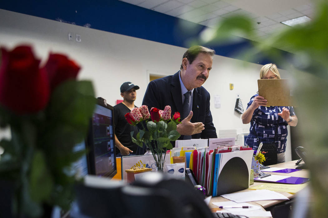 Dr. Federico Zaragoza, the newly appointed president of the College of Southen Nevada, left, talks with administrative assistant Sandra Gammage, not pictured, while touring the CSN West Charleston ...
