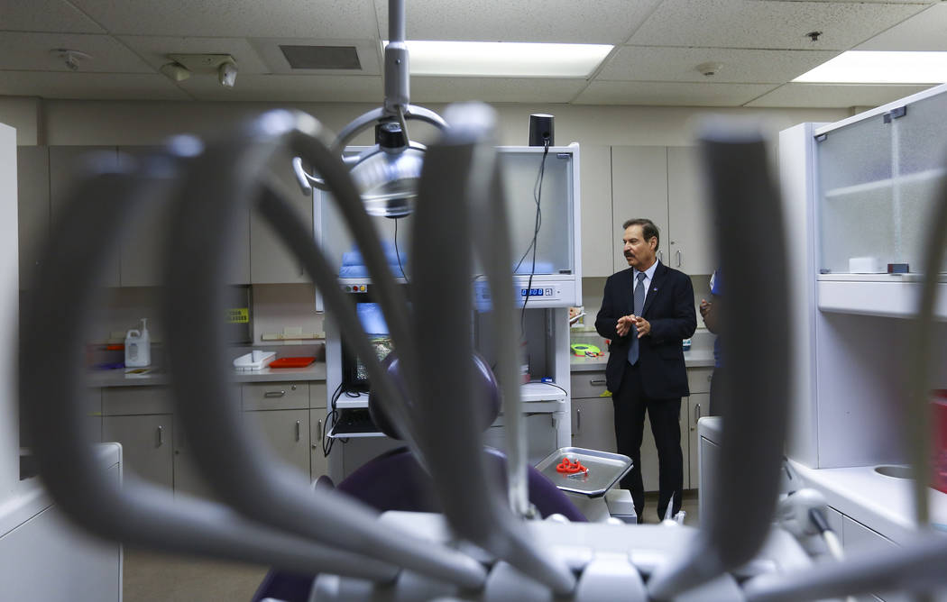 Dr. Federico Zaragoza, the newly appointed president of the College of Southen Nevada, walks through the school's dental labs while touring the CSN West Charleston campus during his second day on ...