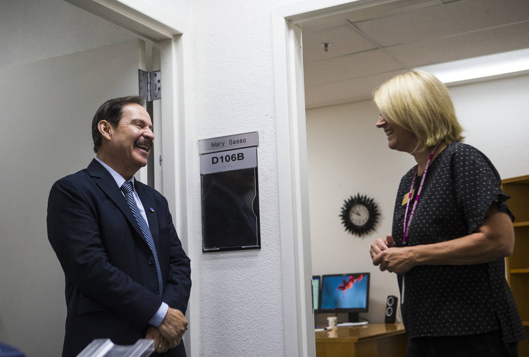 Federico Zaragoza, the newly appointed president of the College of Southern Nevada, talks with Mary Sasso, director of the International Student Center, while touring the CSN Charleston campus dur ...