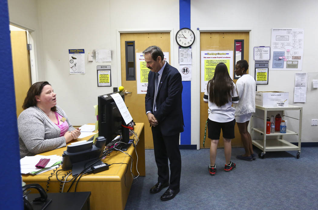 Dr. Federico Zaragoza, the newly appointed president of the College of Southen Nevada, talks with administrative assistant Brittney Leavitt while touring the CSN West Charleston campus during his ...