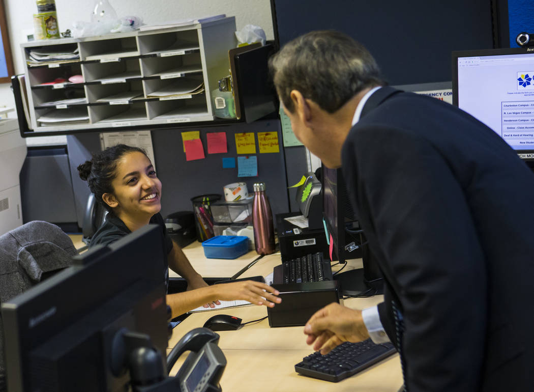 Dr. Federico Zaragoza, the newly appointed president of the College of Southen Nevada, talks with student worker Dyanne Ruvalcaba while touring the CSN West Charleston campus during his second day ...