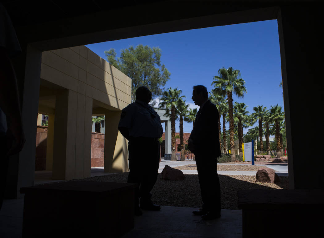 Dr. Federico Zaragoza, the newly appointed president of the College of Southen Nevada, right, talks with a security officer while touring the CSN West Charleston campus during his second day on th ...
