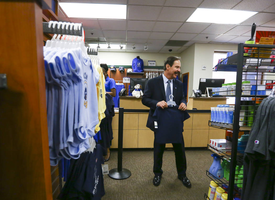 Dr. Federico Zaragoza, the newly appointed president of the College of Southen Nevada, gets T-shirts for his grandchildren at the campus bookstore while touring the CSN West Charleston campus duri ...