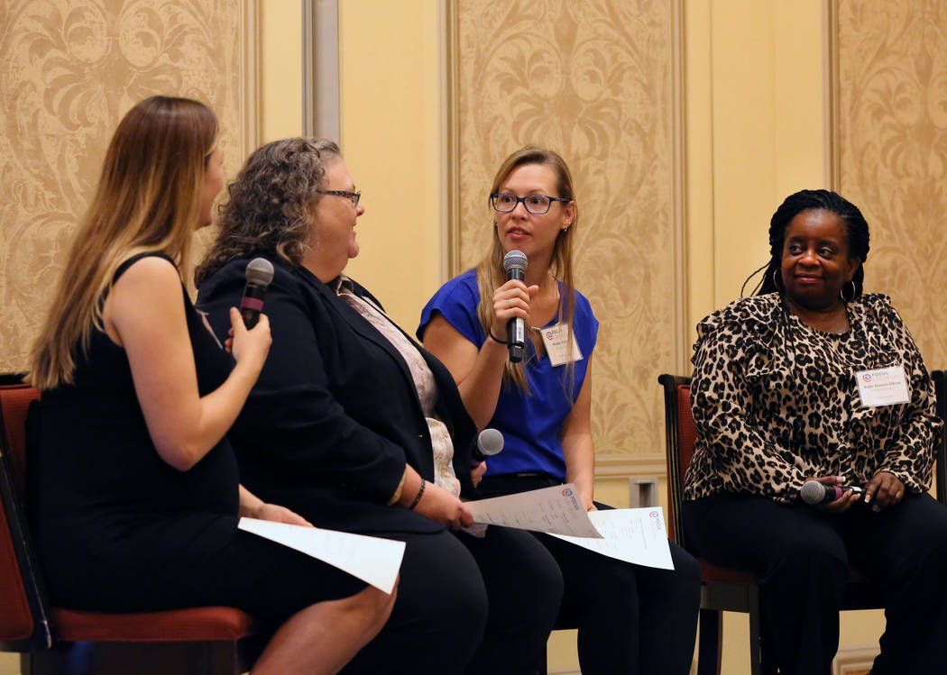 Mandy Martin, second right, director of Corporate Citizenship, Las Vegas Sandy Corporation, speaks as Emily Paulsen, left, executive director, Nevada Homeless Alliance, Michele Fuller-Hallauer, ma ...