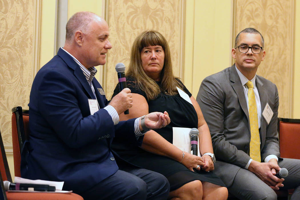 Steve Schmidt, left, senior VP and COO, Catholic Charities of Southern Nevada, speaks as Kelly Robson, chief social services officer, HELP of Southern Nevada, and Craig Kirkland, right, executive ...
