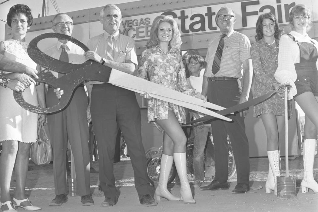 The opening of the 1971 Jaycees State Fair. This image is of Las Vegas Mayor Oran Gragson holding a giant pair of scissors during the ribbon cutting ceremony with Queen candidate Marla Carpenter a ...