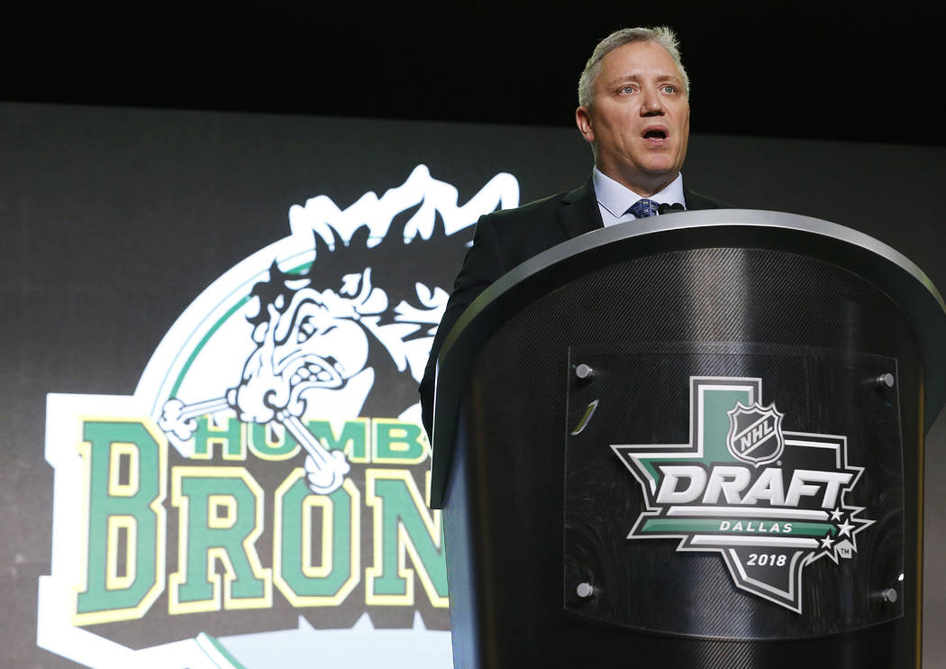 In this June 22, 2018, file photo, Kevin Garinger, President of the Humboldt Broncos junior hockey team, accepts the E.J. McGuire Award of Excellence during the NHL hockey draft in Dallas. (AP Pho ...