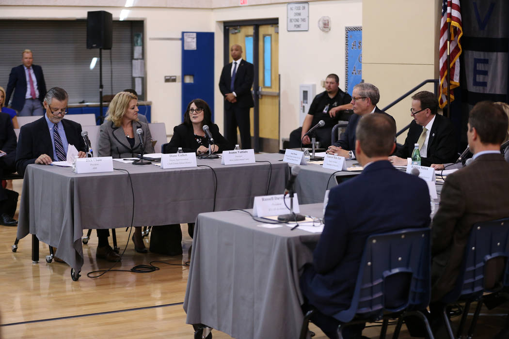 Miley Achievement Center Principal Joanne Vattiato, third from left, speaks during a Federal Commission on School Safety Listening Session at the Miley Achievement Center in Las Vegas, Thursday, A ...