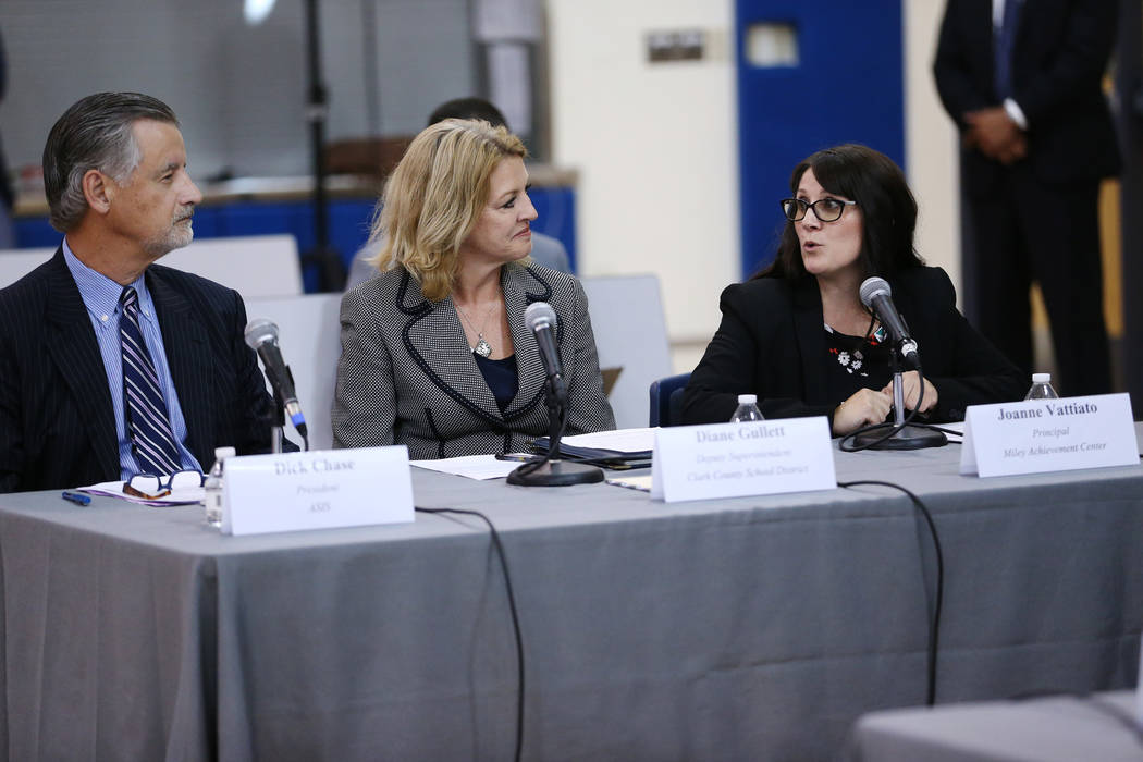 """Miley Achievement Center Principal Joanne Vattiato, right, speaks during a Federal Commission on School Safety Listening Session at the Miley Achievement Center in Las Vegas, with Richard """" ..."""