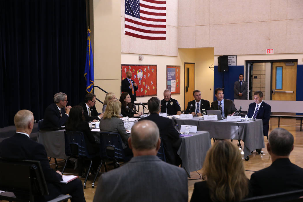 Paul Timm, second from right, vice president of Facility Engineering Associates, speaks during a Federal Commission on School Safety Listening Session at the Miley Achievement Center in Las Vegas, ...