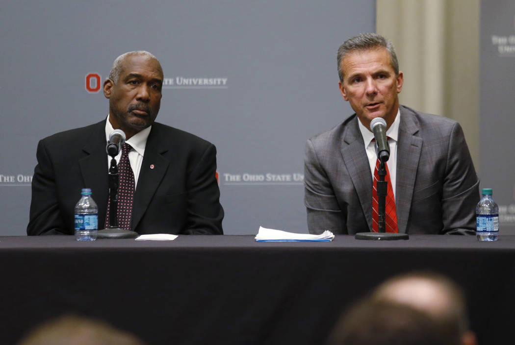 Ohio State football coach Urban Meyer, right, answers questions as athletic director Gene Smith listens during a news conference in Columbus, Ohio, Wednesday, Aug. 22, 2018. Ohio State suspended M ...