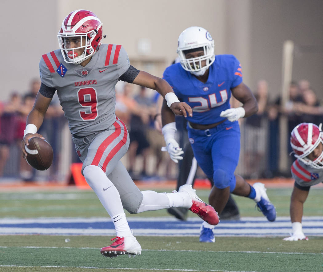 Mater Dei junior quarterback Bryce Young (9) sprints up field past Bishop Gorman junior linebacker Bryan Certain (24) in the second quarter on Friday, Aug. 24, 2018, at Bishop Gorman High School, ...