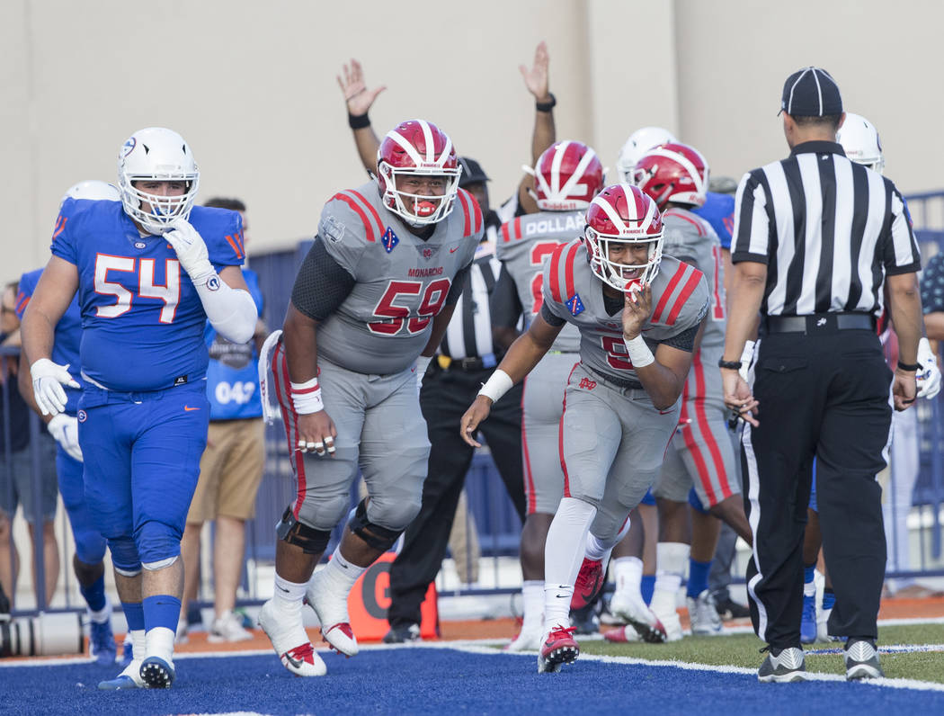 Mater Dei senior wide receiver Bru Mccoy (5) celebrates after scoring a first quarter touchdown during the Monarchs road matchup with Bishop Gorman on Friday, Aug. 24, 2018, at Bishop Gorman High ...
