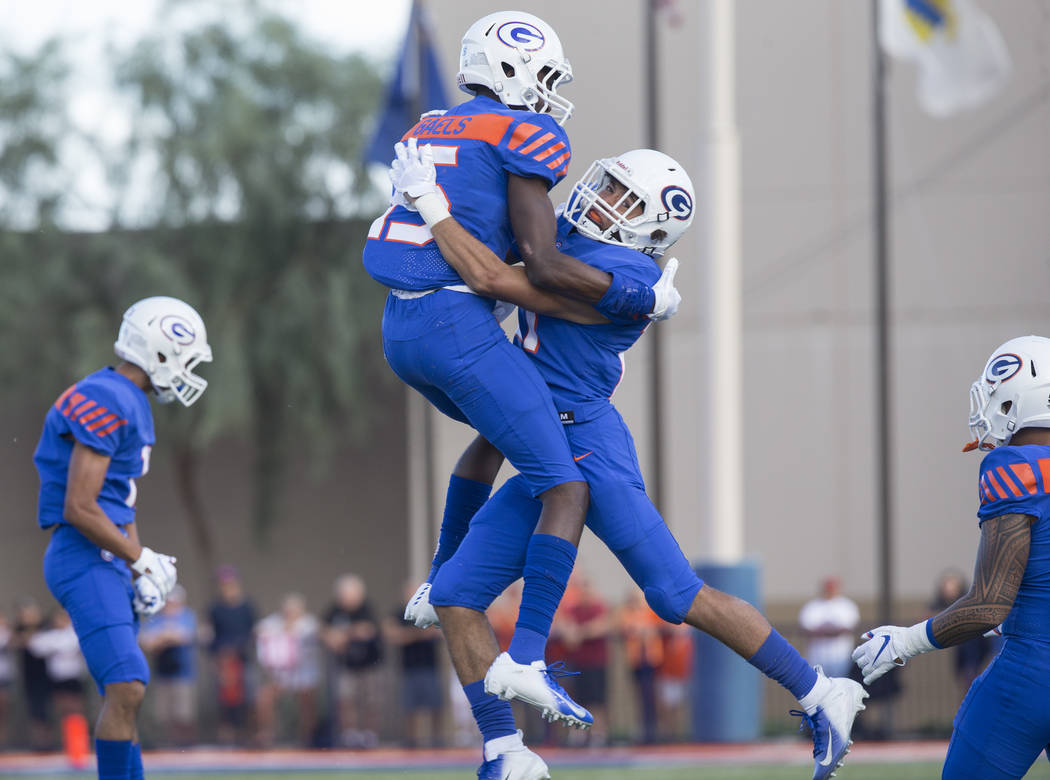 Bishop Gorman defensive backs Kyu Kelly (15) and Ammonte Beverly (21) celebrate after recovering a fumble in the first quarter during the Gaels home matchup with Mater Dei on Friday, Aug. 24, 20 ...