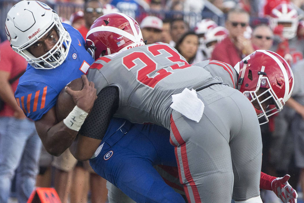 Bishop Gorman junior quarterback Micah Bowens (1) is tackled near the goal line by Mater Dei junior linebacker Raymond Leutele (23) in the second quarter on Friday, Aug. 24, 2018, at Bishop Gorman ...