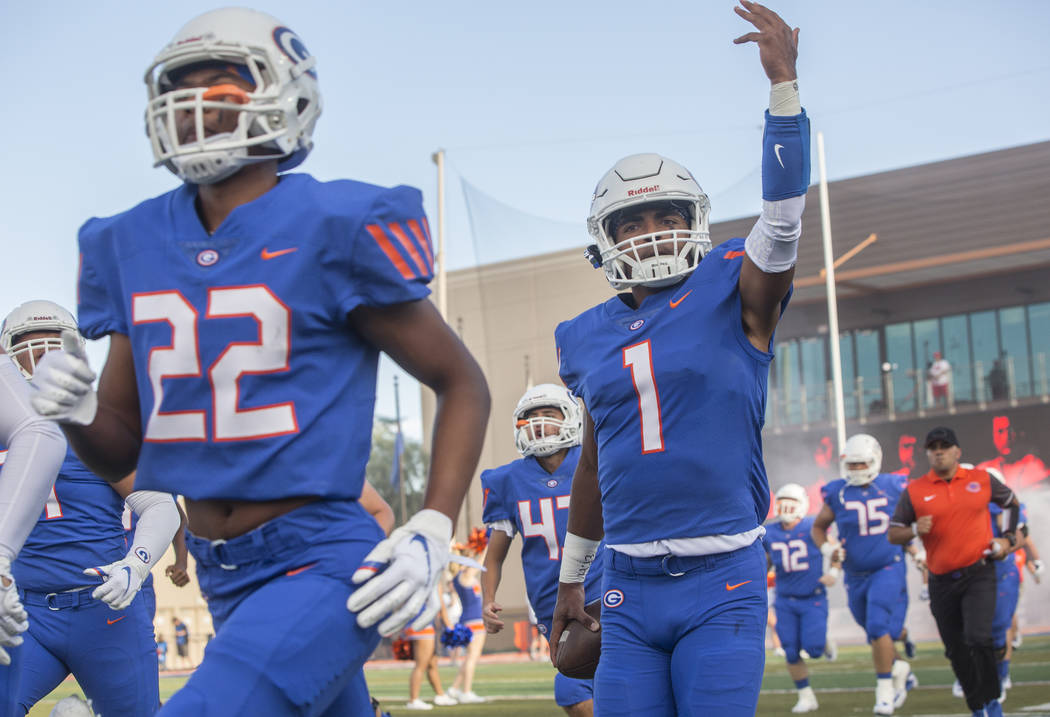 Bishop Gorman junior quarterback Micah Bowens (1) salutes the crowd as the Gaels take the field before the start of their home matchup with Mater Dei on Friday, Aug. 24, 2018, at Bishop Gorman Hig ...