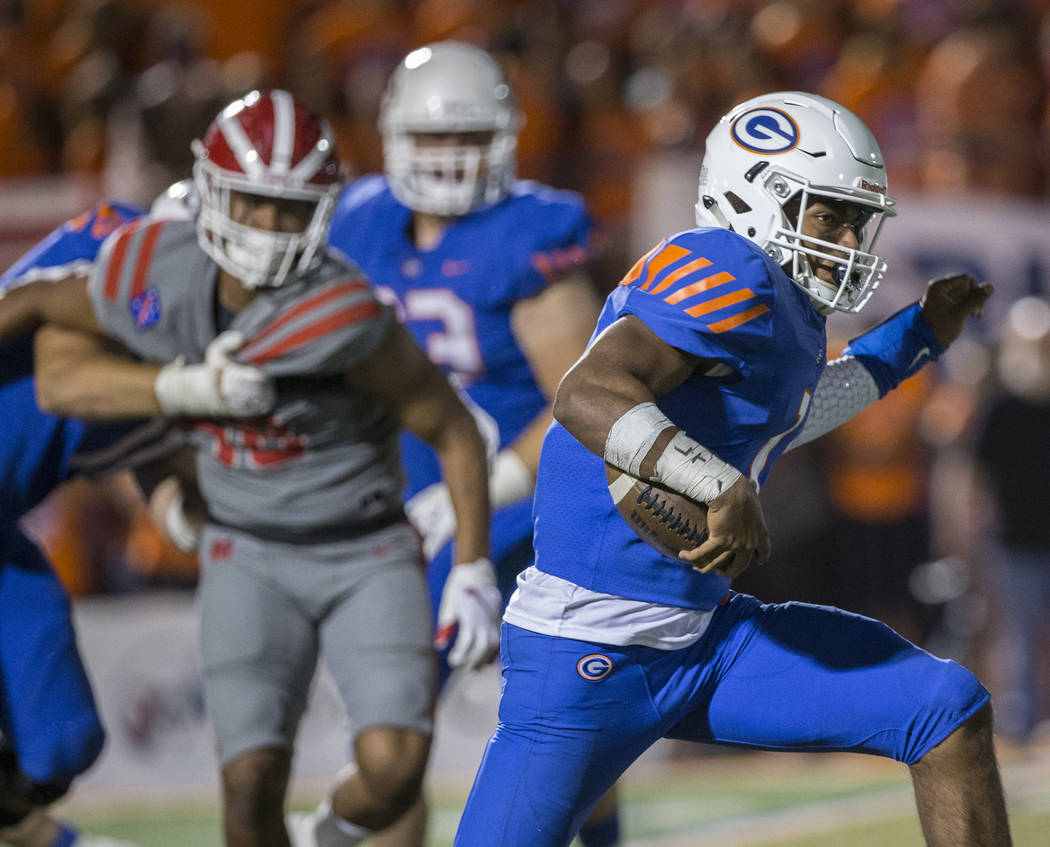 Bishop Gorman junior quarterback Micah Bowens (1) breaks a big run in the third quarter during the Gaels home matchup with Mater Dei on Friday, Aug. 24, 2018, at Bishop Gorman High School, in Las ...