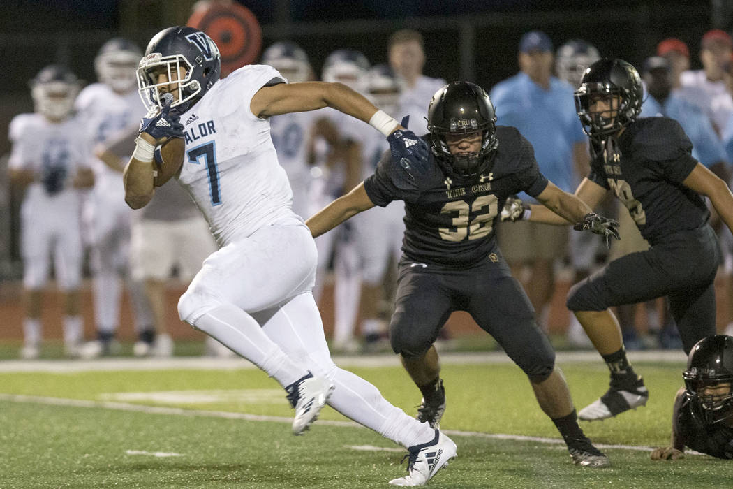 Valor Christian (Colorado) running back Joshia Davis (7) breaks through Faith Lutheran defenders for a touchdown during the first half of varsity football game at Faith Lutheran High School in Las ...
