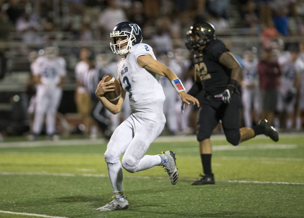Valor Christian (Colorado) quarterback Luke McCaffrey (2) carries the ball for a touchdown against Faith Lutheran during the second half of varsity football game at Faith Lutheran High School in L ...