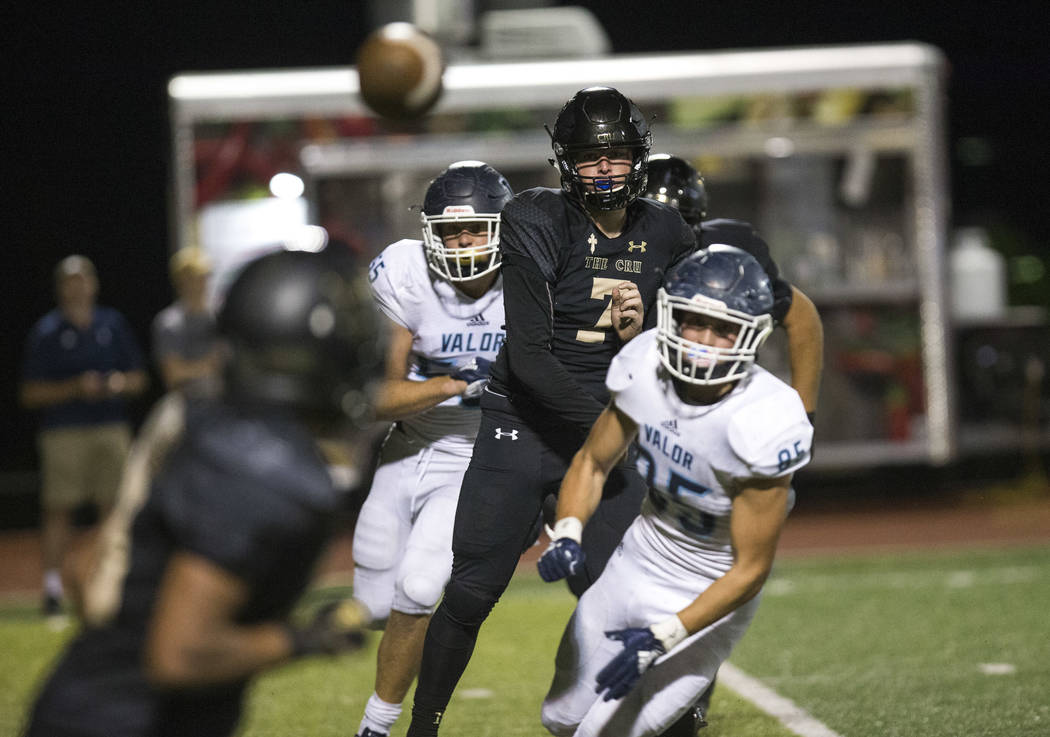 Faith Lutheran quarterback Sagan Gronauer (7), second right, throws to a receiver against Valor Christian (Colorado) during the second half of varsity football game at Faith Lutheran High School i ...