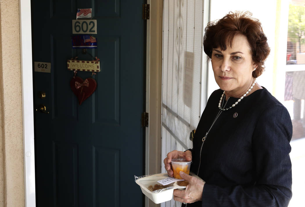 U.S. Rep. Jacky Rosen, D-Nev, stands outside of a house as she prepares to deliver meal to a seniors citizen on Thursday, Aug. 16, 2018, in Boulder City. Bizuayehu Tesfaye/Las Vegas Review-Journal ...