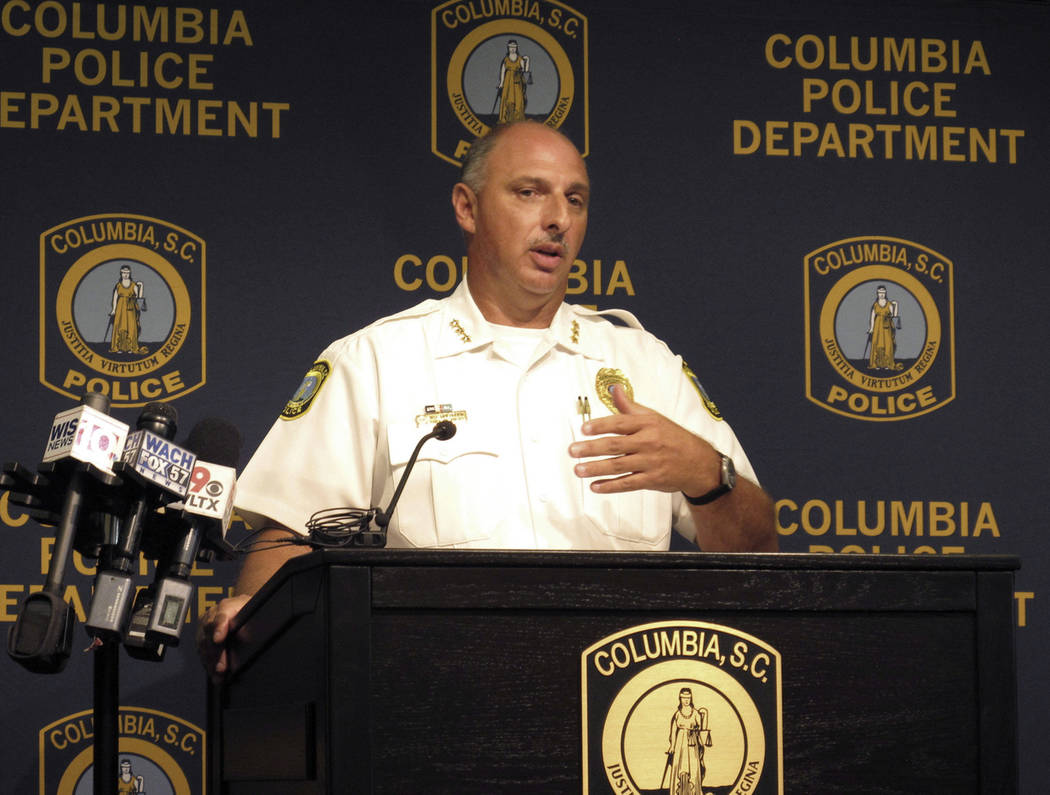 "Columbia Police Chief Skip Holbrook talks Thursday, Aug. 23, 2018, in Columbia, S.C., about an investigation into the heat-related death of police dog ""Turbo"" in July. (AP Photo/Jeffrey Collins)"