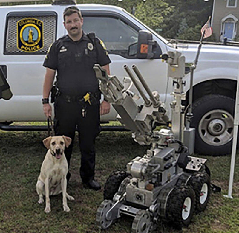 "Master Police Officer David Hurt is seen with his police dog ""Turbo."" (Columbia, S.C. Police Department via AP)"