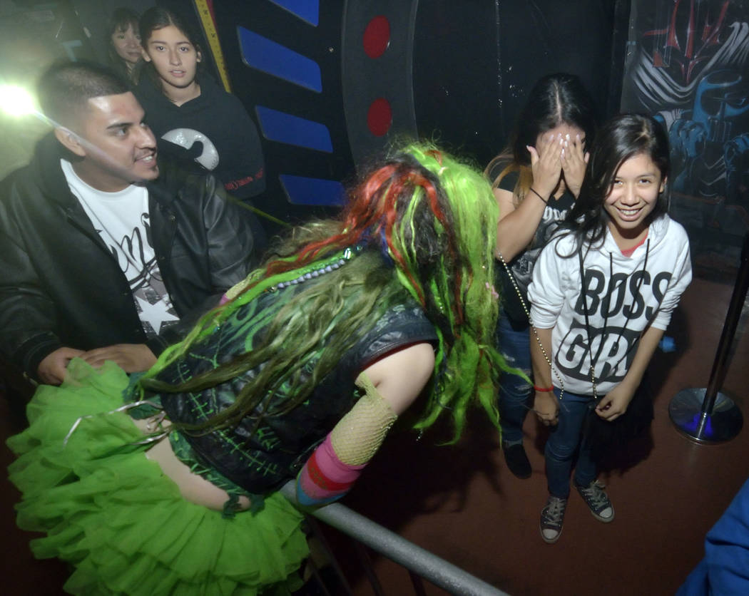 Alexandra Tellefsen, as Little Psycho, center, greets Anali Flores, right, and her sister Yanira as they wait in line at the Fright Dome in Adventuredome at the Circus Circus hotel-casino at 2880 ...