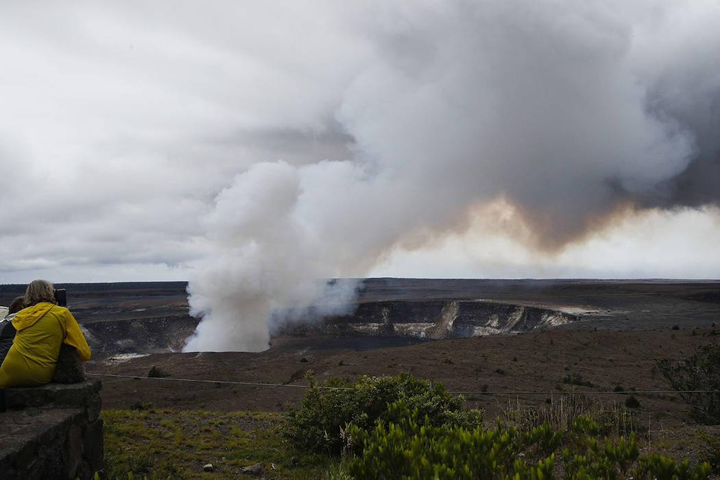 Steam and gas rise from Kilauea's summit crater in Hawaii Volcanoes National Park, Hawaii, in May 2018. (AP Photo/Jae C. Hong)