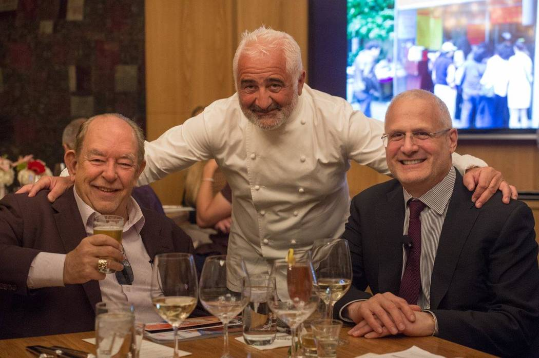 "Vegas Uncork'd's ""A Culinary Journey Around the World"" hosted by Robin Leach and Gary Selesner, here flanking Guy Savoy, on Friday, April 28, 2017, at Bacchanal Buffet at Caesars Palace in Las Veg ..."