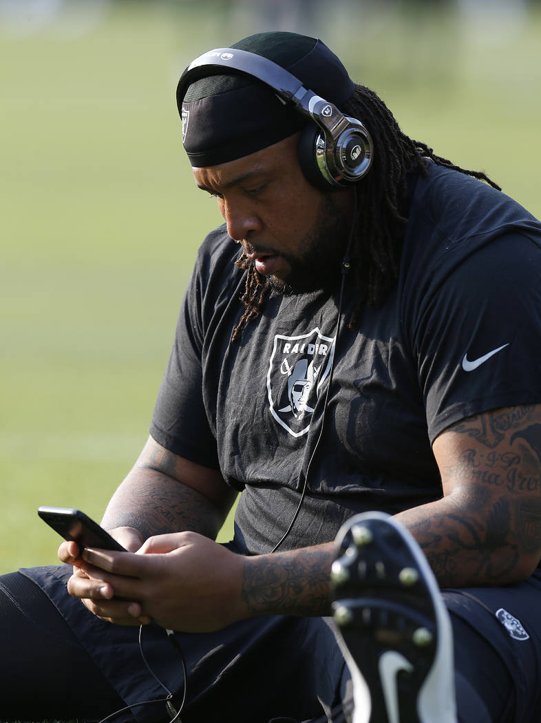 Oakland Raiders tackle Donald Penn stretches before an NFL preseason football game against the Green Bay Packers in Oakland, Calif., Friday, Aug. 24, 2018. (AP Photo/D. Ross Cameron)