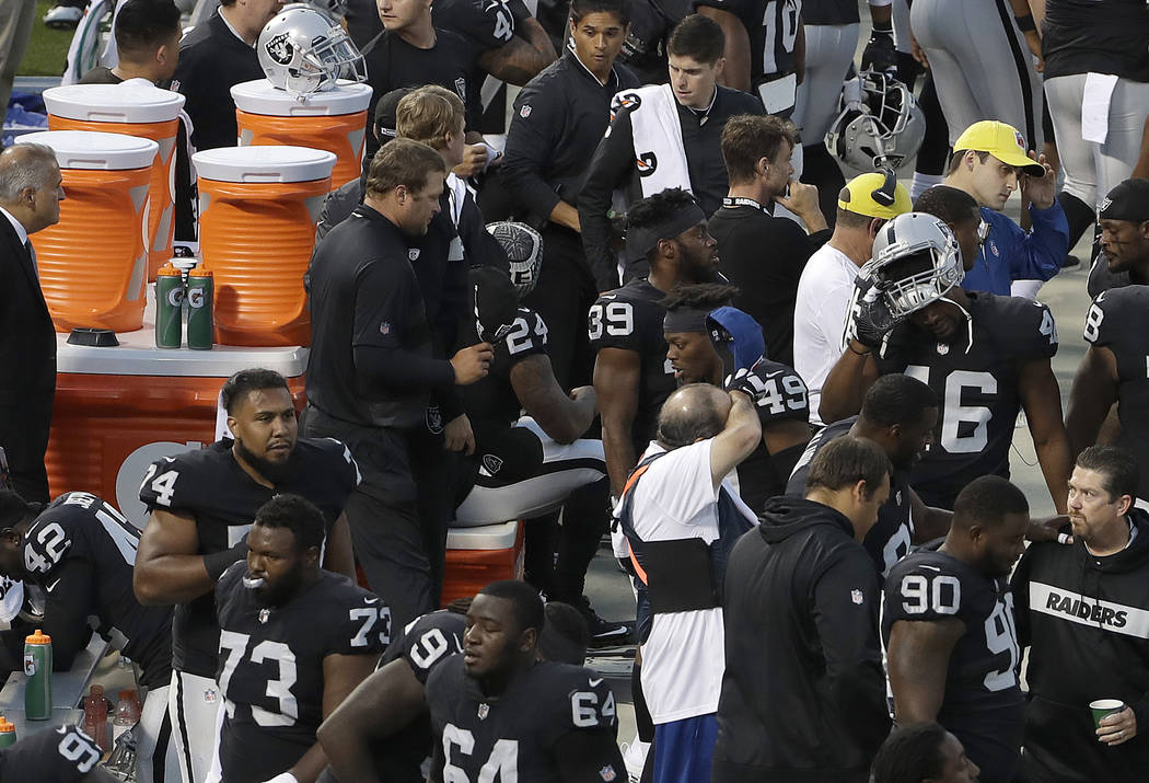 Oakland Raiders running back Marshawn Lynch (24) sits before the national anthem before an NFL preseason football game between the Raiders and the Green Bay Packers in Oakland, Calif., Friday, Aug ...