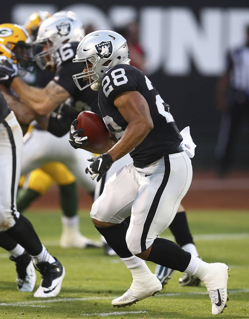 Oakland Raiders running back Doug Martin (28) runs against the Green Bay Packers during the first half of an NFL preseason football game in Oakland, Calif., Friday, Aug. 24, 2018. (AP Photo/Ben Ma ...