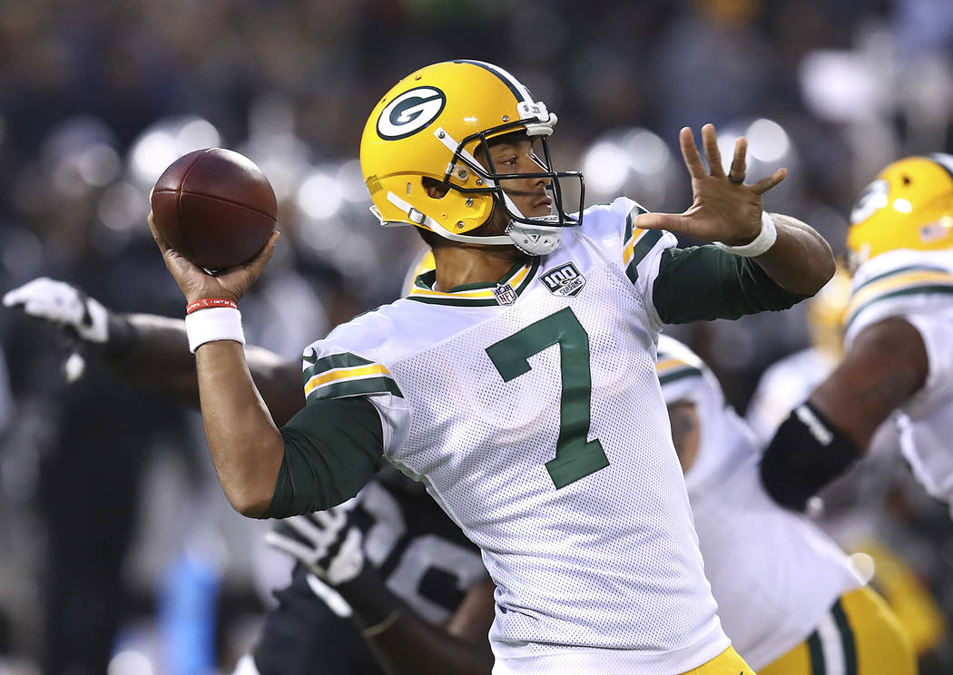 Green Bay Packers quarterback Brett Hundley (7) throws a pass against the Oakland Raiders during the first half of an NFL preseason football game in Oakland, Calif., Friday, Aug. 24, 2018. (AP Pho ...