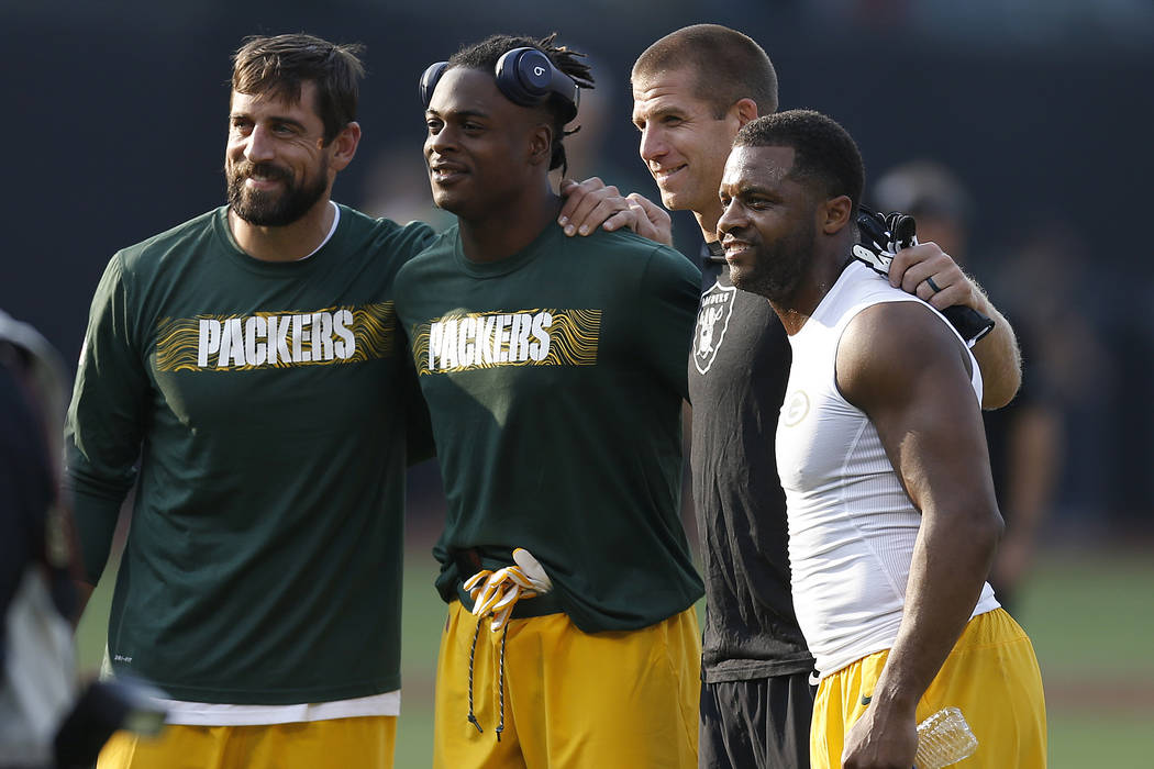 Oakland Raiders wide receiver Jordy Nelson, second from right, poses for photos with Green Bay Packers players Aaron Rodgers, from left, Davante Adams and Randall Cobb before an NFL preseason foot ...