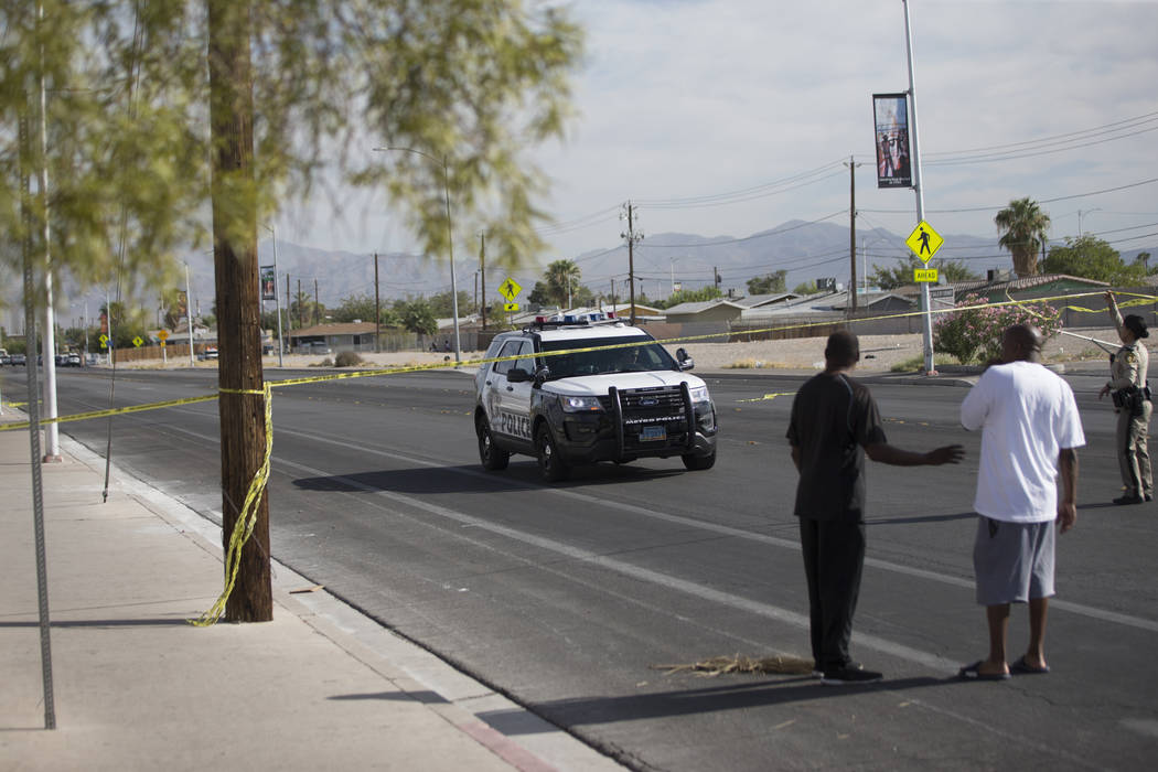 Las Vegas police investigate an officer-involved shooting at Doolittle Avenue near H Street in Las Vegas on Saturday, Aug. 25, 2018. Chase Stevens Las Vegas Review-Journal @csstevensphoto