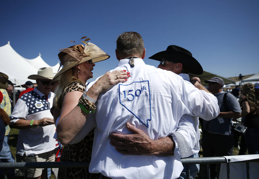 U.S. Sen. Dean Heller, center, visits with supporters at the 4th annual Basque Fry in Gardnerville, Nev., on Saturday, Aug. 25, 2018. Hosted by the Morning in Nevada PAC, the event is a fundraiser ...