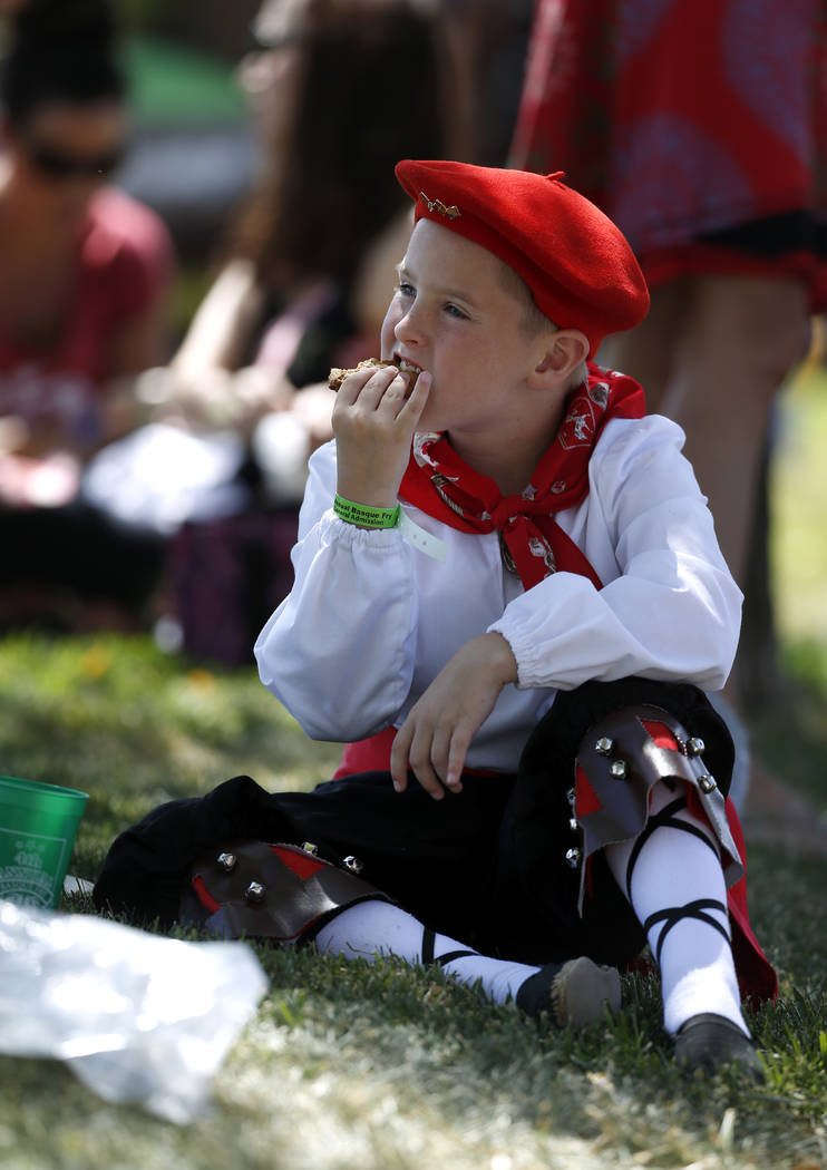 Alex Sarratea, 8, enjoys a cookie before preforming with the Mendiko Euskaldun Cluba Basque Dancers at the 4th annual Basque Fry in Gardnerville, Nev., on Saturday, Aug. 25, 2018. Hosted by the Mo ...