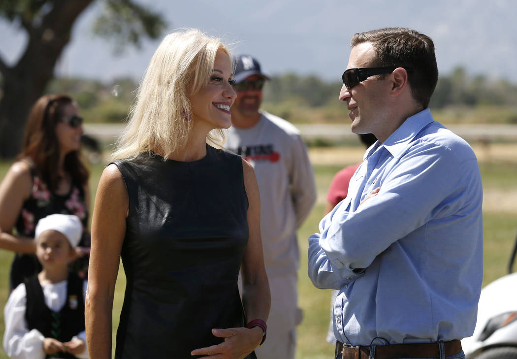 Kellyanne Conway talks to Nevada Attorney General Adam Laxalt at the 4th annual Basque Fry in Gardnerville, Nev., on Saturday, Aug. 25, 2018. Hosted by the Morning in Nevada PAC, the event is a fu ...