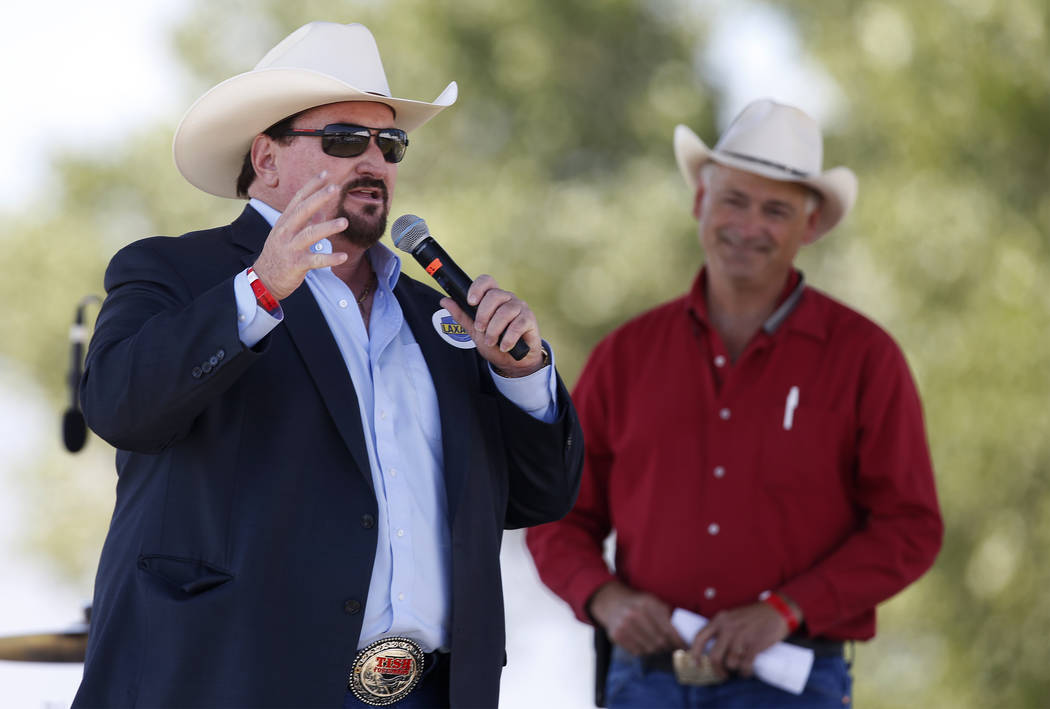 Nevada Sen. James Settelmeyer, R-Gardnerville, listens as state Republican Party Chair Michael McDonald speaks at the 4th annual Basque Fry in Gardnerville, Nev., on Saturday, Aug. 25, 2018. Hoste ...