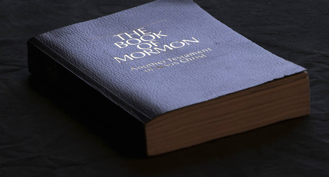 The Book of Mormon is shown Tuesday, Aug. 21, 2018, Salt Lake City. Sheraton, Westin and other Starwood hotels are finding their religion. Marriott International, which bought Starwood two years a ...