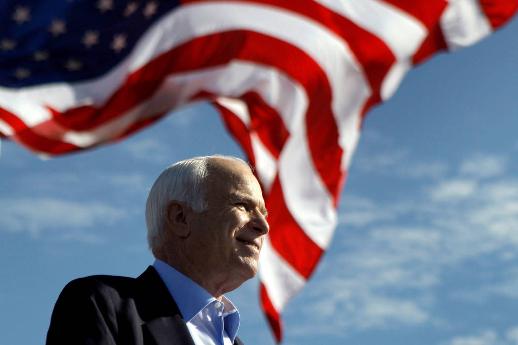 FILE - In this Nov. 3, 2008 file photo, Republican presidential candidate Sen. John McCain, R-Ariz. speaks at a rally outside Raymond James Stadium in Tampa, Fla. McCain's family says the Arizona ...