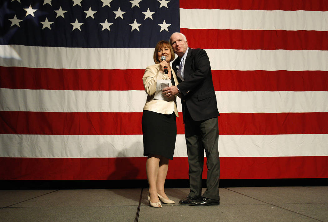 In this Oct. 29, 2010, file photo, Sen. John McCain embraces Sharron Angle during a rally at The Orleans in Las Vegas. John Locher Las Vegas Review-Journal, File