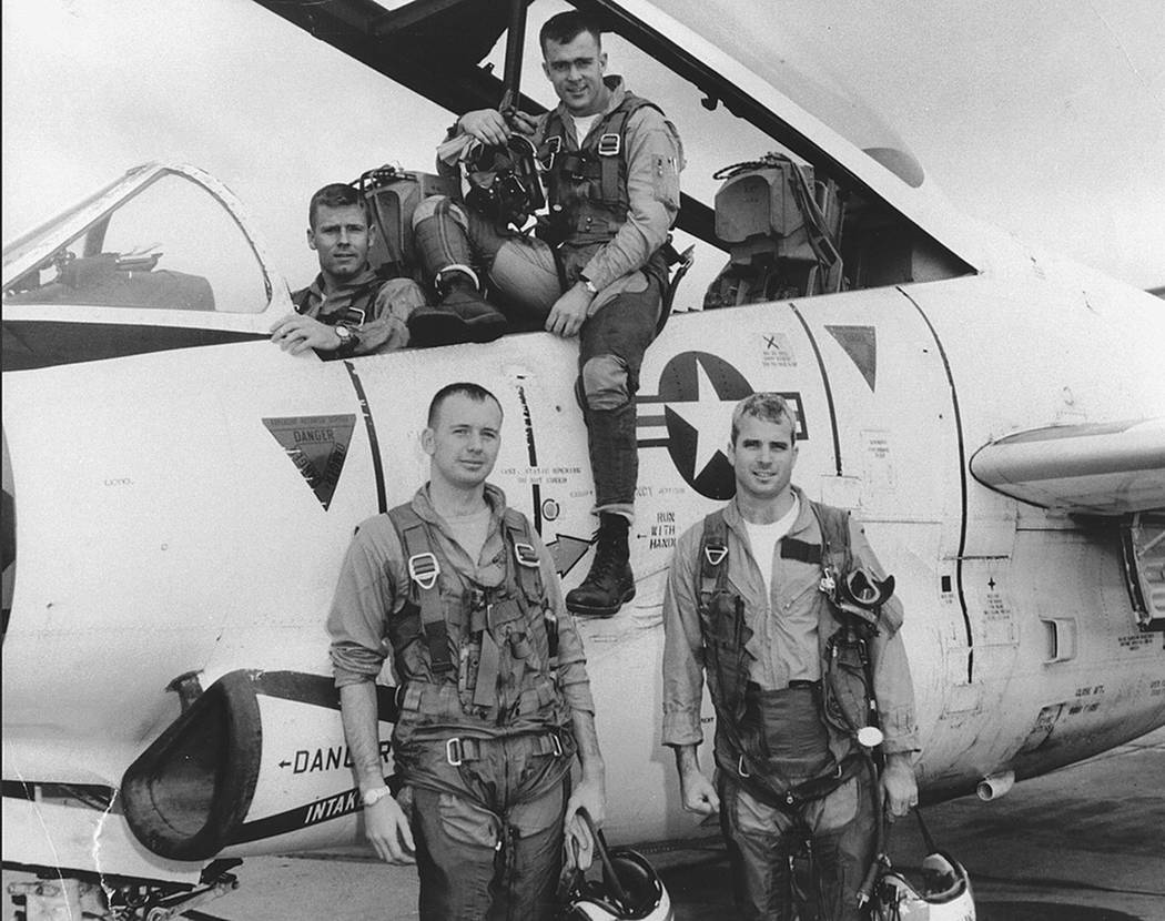 This photo provided by the Library of Congress shows John McCain, (front, right) with his squadron in 1965. McCain, a former Navy fighter pilot, was captured by the Vietnamese, tortured and impris ...