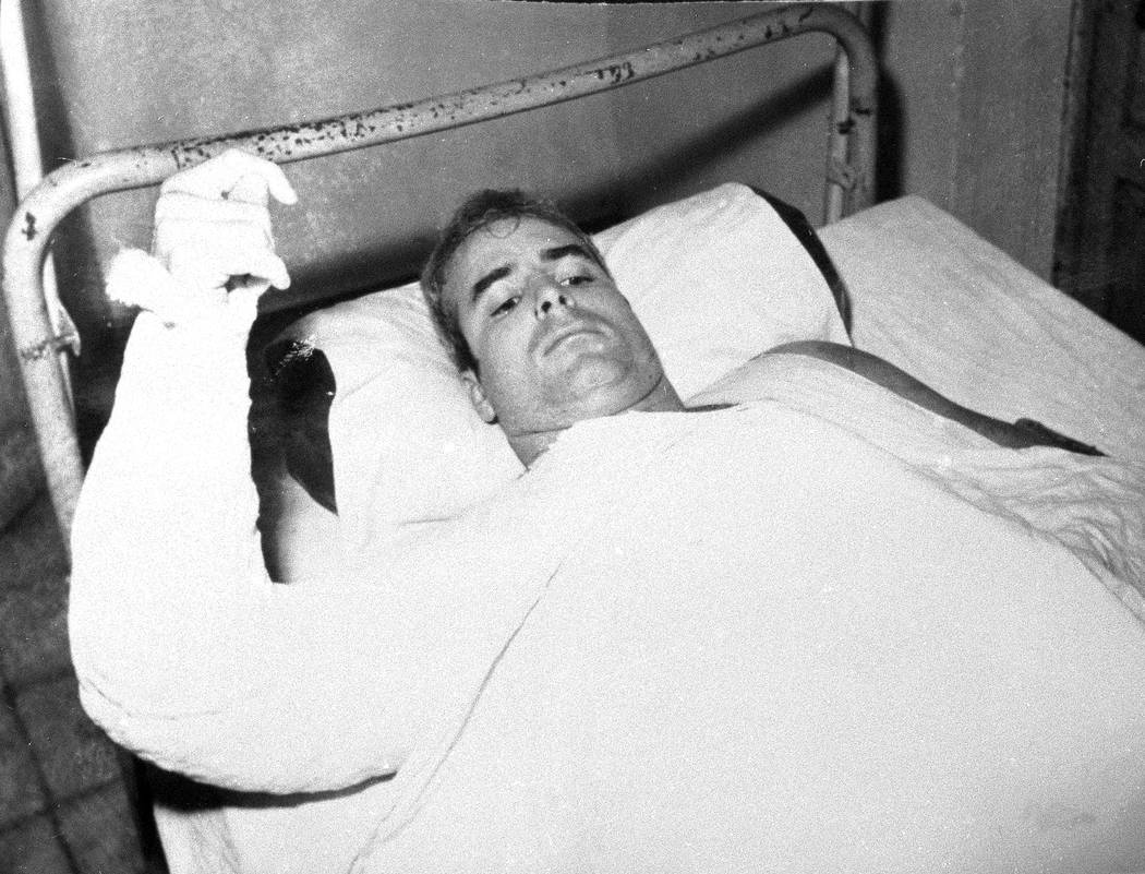 LCdr. John S. McCain, USN, is shown in this undated photo lying injured in North Vietnam wearing an arm cast. He was a held prisoner during the Vietnam War. (AP Photo/CBS)