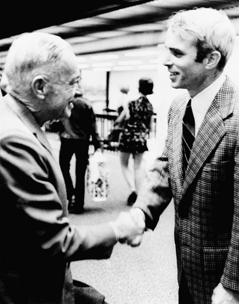 Adm. John S. McCain Jr. (left) and his son, Lt. Cmdr. John S. McCain III meet for the first time in Jacksonville, Fla., March 31, 1973, since the younger McCain returned from a North Vietnam priso ...