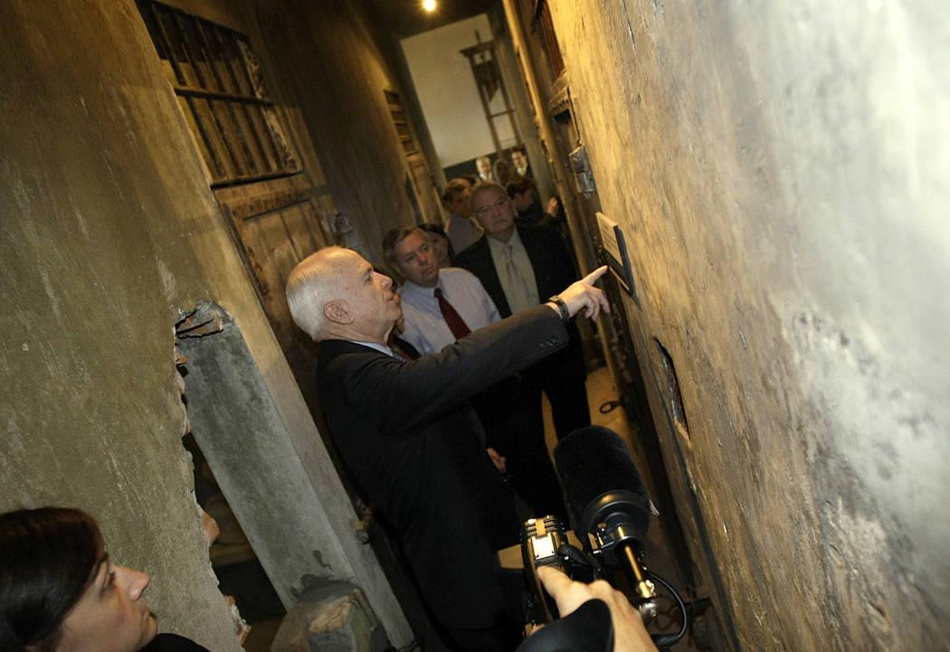 "In this April, 8, 2009, file photo, U.S. Sen. John McCain, R-Ariz, tours the Hoa Lo prison, nicknamed ""The Hanoi Hilton"" by American prisoners, in Hanoi, Vietnam. McCain was a P.O.W. at ..."
