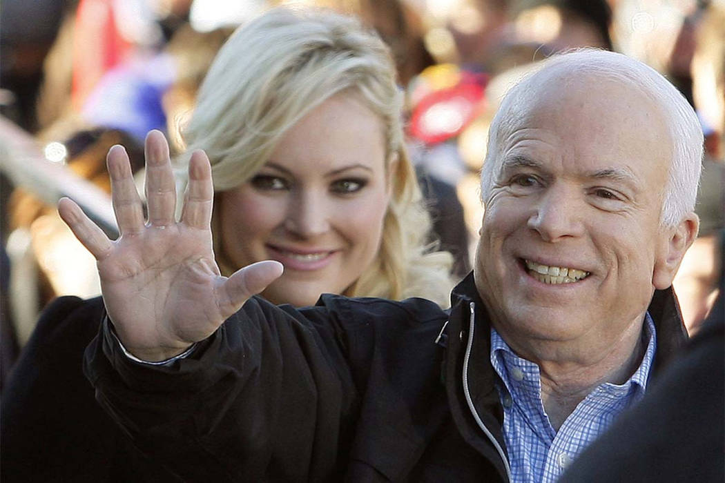 FILE - In this Oct. 30, 2008 file photo, Republican presidential candidate Sen. John McCain, R-Ariz., accompanied by his daughter Meghan McCain, waves to supporters as he enters a campaign rally i ...